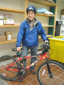 Mt. Edgecumbe High School sophomore Nelson Kanuk, who is from the Yukon-Kuskokwim Delta village of Kipnuk, checks out a bike from the boarding school's bike program so he can run errands in Sitka. (Photo courtesy of Mt. Edgecumbe High School bike program)
