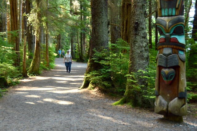 Betty Jo Whitcomb takes her daily walk among the totem poles at Sitka National Historical Park. She is the first recipient of a quarterly $100 cash prize for participants of the park's Park Prescription Program. (NPS Photo by Michael Hess)