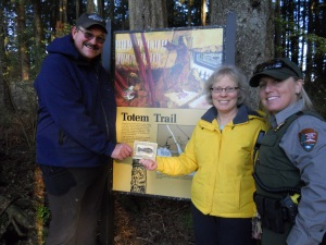 Sitka National Historical Park Senior Ranger Carin Farley, right, celebrates with Eric and Sarah Jordan after they became the first people to complete a Park Prescriptions punch card.